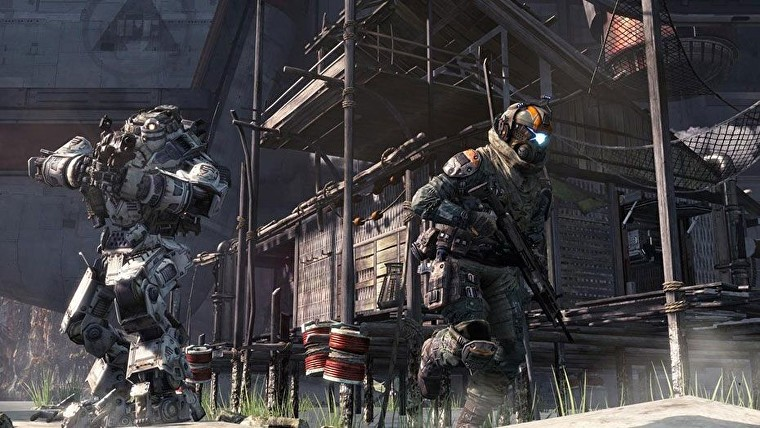 A future soldier runs through a shanty town, pursued by a giant white robot.
